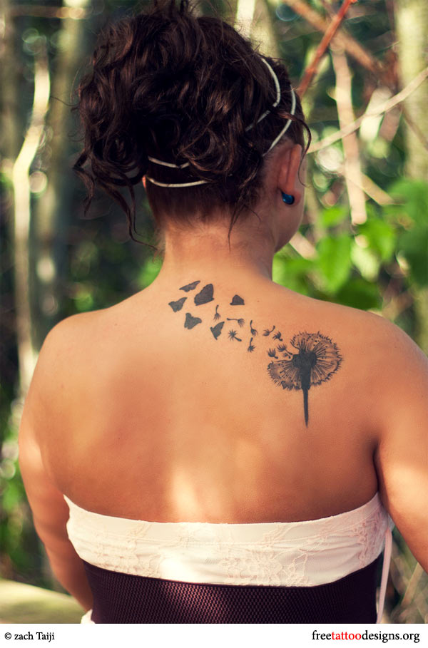 Dandelion and butterflies tattoo on a woman's back