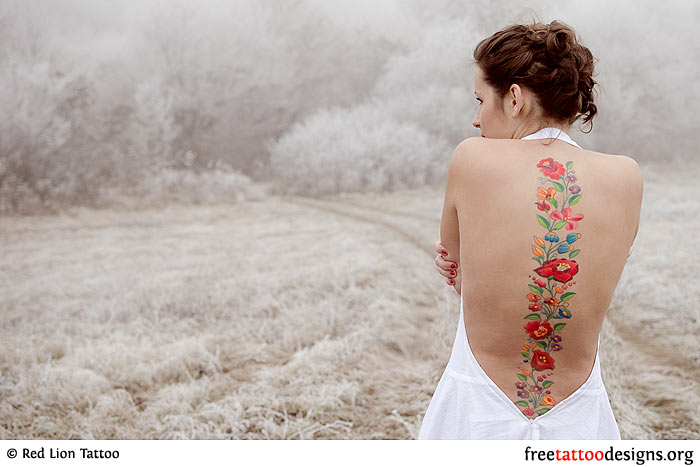 Lady with a flower tattoo on her spine