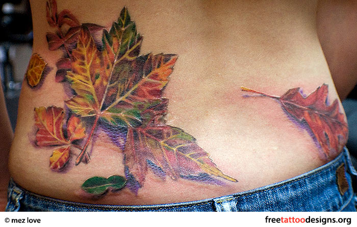 Falling leaves tattoo on a girl's back