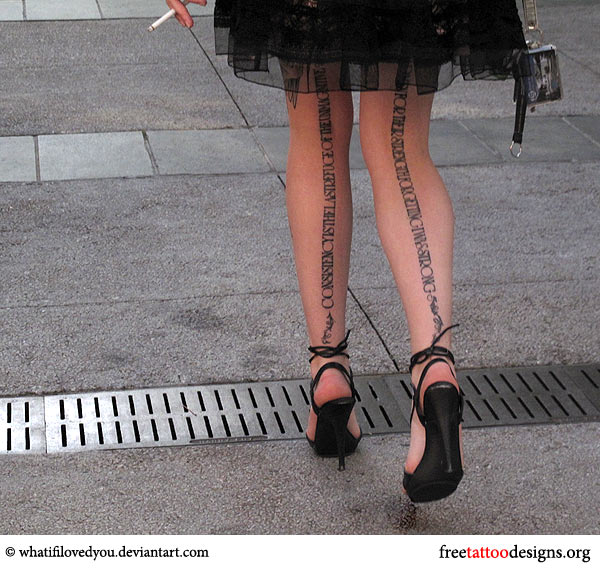 Text tattoo on a woman's legs
