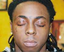 Lil wayne 39 s tattoos meaning and pictures for Tear tattoo meaning on face