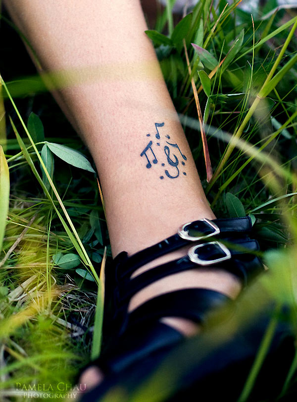 Music notes tattoo on a girl's leg