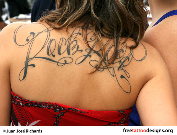 Rock 'n' Roll tattoo on a girl's back