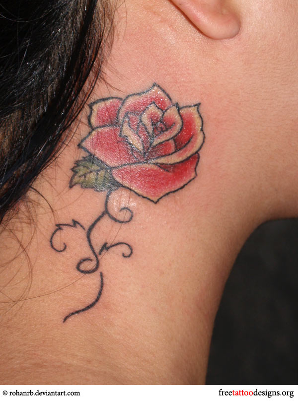 Rose tattoo under a girl's ear