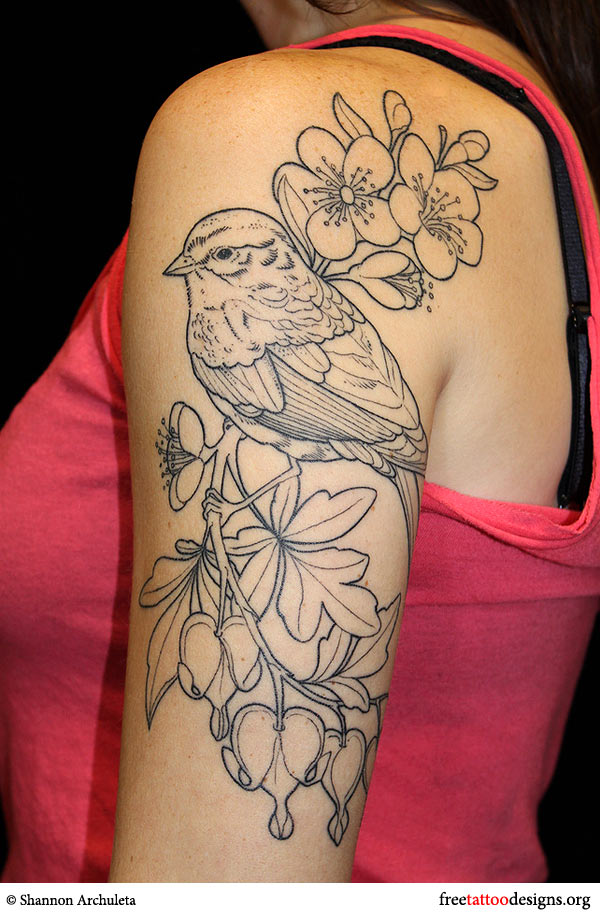 Sparrow and flowers tattoo on a woman's arm