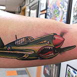Airplane tattoo on a man's arm
