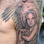 Angel and clouds  on a man's shoulder and arm