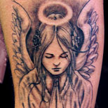 Angel tattoo design with praying hands and a halo