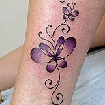 Butterfly tattoo on a girl's ankle