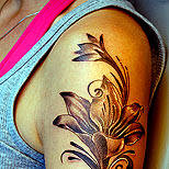 Girl with a flower tattoo on her arm