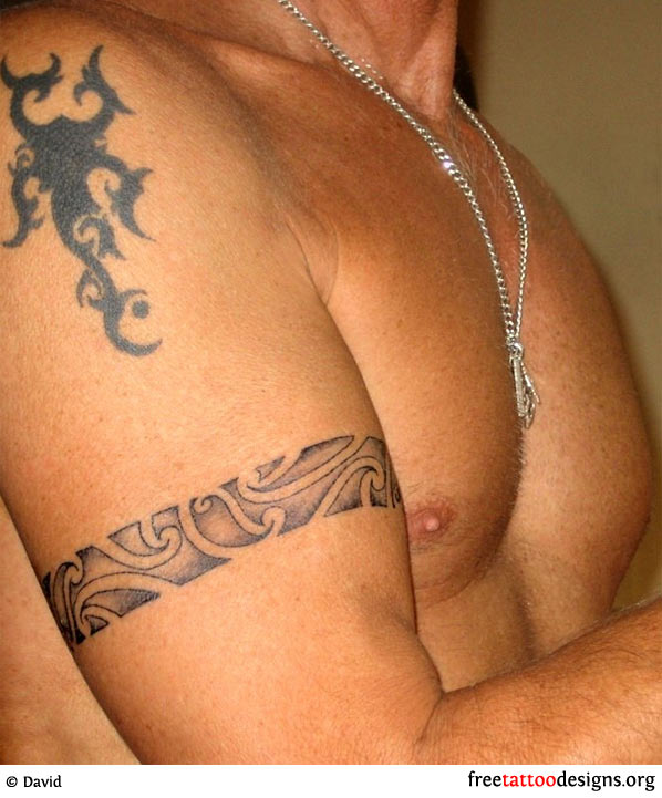 tribal arband tattoo around a man 39 s biceps. Black Bedroom Furniture Sets. Home Design Ideas