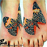 Big butterfly tattoo on foot