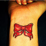 Red bow tattoo