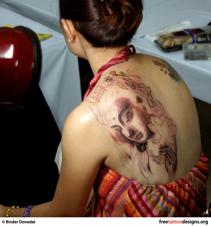 Buddha art tattoo on a girl's back