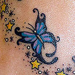 Butterflies and stars tattoo on foot