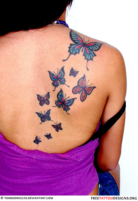 butterflies tattoo on a woman 39 s back