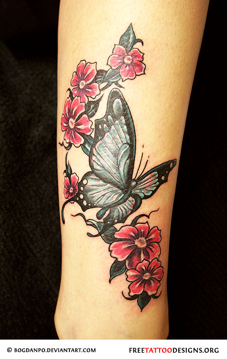 0b7f42a56 Butterflies tattoo on a woman's back, Butterfly and flowers tattoo on arm  ...