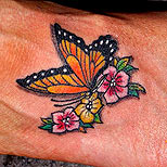 Butterfly and flowers tattoo on foot