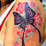 Butterfly flowers tattoo on a woman's arm