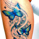 Butterfly and stardust tattoo on leg