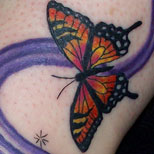 Monarch butterfly tattoo design on a girl's foot
