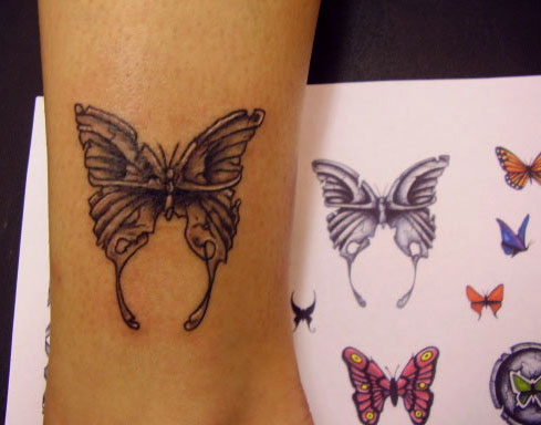 Female butterfly tattoo