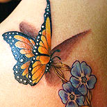 Butterfly and violets tattoo