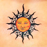 Celtic tribal sun tattoo