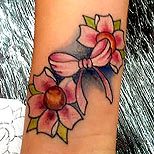 Cherry blossom and pink bow tattoo