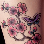 Cherry blossom and butterfly tattoo