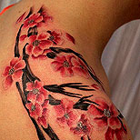 Cherry blossom tree tattoo on a girl's shoulder