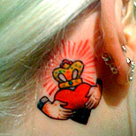 Claddagh tattoo behind a girl's ear