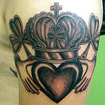 Claddagh tattoo on a man's arm
