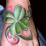 Clover tattoo on foot