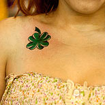 Clovers tattoo on a girl's chest