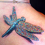 Dragonfly tattoo with cool wings on a man's shoulder