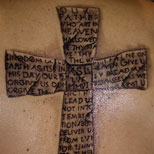 Cross and text tattoo