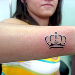 Crown tattoo on a girl's arm