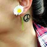 Daisy and peace sign tattoo