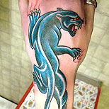 The famous Dietzel panther tattoo design on a man's leg