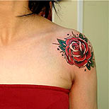 Double rose tattoo on a woman's shoulders