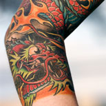 Dragon Art Tattoo on a woman's arm