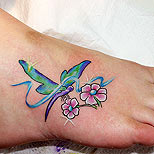 Dragonfly tattoo on foot
