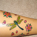 Dragonfly tattoo on a girl's leg