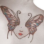 Butterfly face tattoo on a woman's back