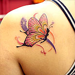 Fairy with butterfly wings tattoo