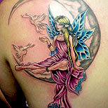 Fairy, moon and doves tattoo