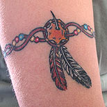 Native American armband tattoo with feathers