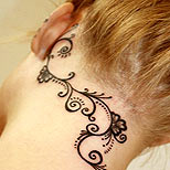 Feminine neck tattoo