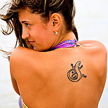 Girl with a gecko/yin yang tattoo on her back